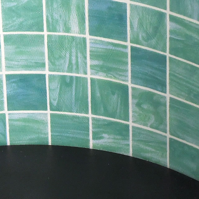緑色のミニ仏壇なので、観葉植物を置いたリビングにも調和する色合いです。